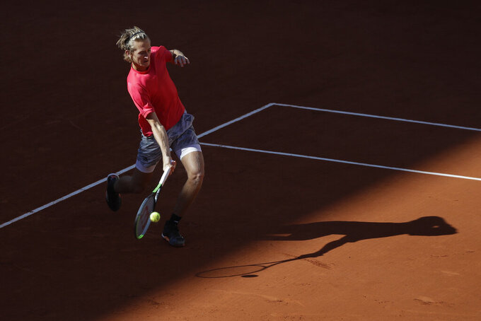 Sebastian Korda of the U.S. plays a shot against Spain's Rafael Nadal in the fourth round match of the French Open tennis tournament at the Roland Garros stadium in Paris, France, Sunday, Oct. 4, 2020. (AP Photo/Alessandra Tarantino)