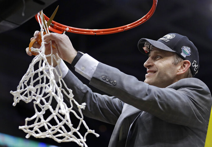 Buffalo coach Nate Oats cuts the net after Buffalo defeated Bowling Green 87-73 in an NCAA college basketball game for the Mid-American Conference men's tournament championship Saturday, March 16, 2019, in Cleveland. (AP Photo/Tony Dejak)