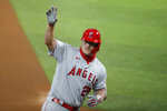 Los Angeles Angels' Mike Trout waves to the dugout after hitting a two-run home run in the first inning of a baseball game against the Texas Rangers in Arlington, Texas, Friday, Aug. 7, 2020. The shot scored David Fletcher. (AP Photo/Tony Gutierrez)
