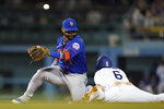 New York Mets shortstop Jonathan Villar (1) misses a throw to second as Los Angeles Dodgers' Trea Turner, right, steals second base during the fifth inning of a baseball game Thursday, Aug 19, 2021, in Los Angeles. (AP Photo/Ashley Landis)