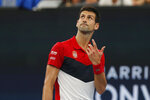 Novak Djokovic of Serbia reacts during their ATP Cup tennis match against Denis Shapovalov of Canada in Sydney, Friday, Jan. 10, 2020. (AP Photo/Steve Christo)