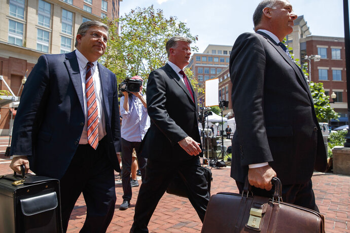 The defense team for Paul Manafort, including Kevin Downing, center, Thomas Zehnle, right, and Richard Westling walk to federal court during the trial of the former Trump campaign chairman, Friday, Aug. 10, 2018, in Alexandria, Va. (AP Photo/Evan Vucci)