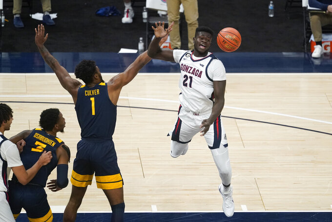 Gonzaga's Oumar Ballo (21) is fouled by West Virginia's Derek Culver (1) during the second half of an NCAA college basketball game Wednesday, Dec. 2, 2020, in Indianapolis. (AP Photo/Darron Cummings)