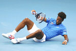 Gael Monfils of France falls to the ground after playing a shot during his match against Cristian Garin of Chile at the ATP Cup tennis tournament in Brisbane, Australia, Saturday, Jan. 4, 2020. (AP Photo/Tertius Pickard)