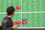 A man looks at an electronic stock board of a securities firm in Tokyo, Monday, Jan. 27, 2020. Shares tumbled Monday in the few Asian markets open as China announced sharp increases in the number of people affected in an outbreak of a potentially deadly virus. (AP Photo/Koji Sasahara)