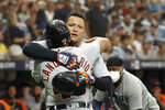 Detroit Tigers' Jeimer Candelario celebrates with teammate Miguel Cabrera after hitting a three-run home run against the Tampa Bay Rays during the first inning of a baseball game Saturday, Sept. 18, 2021, in St. Petersburg, Fla. (AP Photo/Scott Audette)