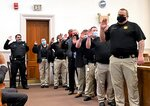 Nine Bamberg County Sheriff Office deputies take an oath on Tuesday, Jan. 5, 2021, at the Bamberg County Courthouse in Bamberg, S.C. (Martha Rose Brown/The Times and Democrat via AP)