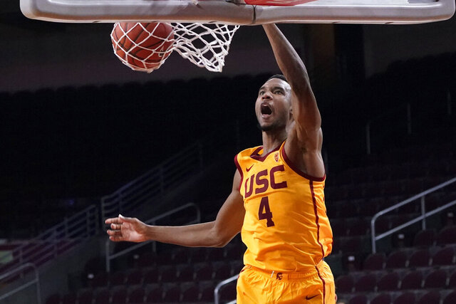 Southern California forward Evan Mobley (4) dunks against Washington during the second half of an NCAA college basketball game Thursday, Jan. 14, 2021, in Los Angeles. (AP Photo/Marcio Jose Sanchez)