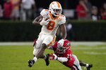 Tennessee running back Ty Chandler (8) break away from Georgia defensive back Christopher Smith (29) after a catch in the second half of an NCAA football game Saturday, Oct. 10, 2020, in Athens, Ga. (AP Photo/John Bazemore)