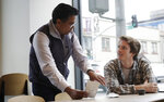 Klatch Coffee owner Bo Thiara, left, talks with customer Daniel Karel while giving Karel a tasting of Elida Natural Geisha coffee at his shop in San Francisco, Wednesday, May 15, 2019. The California cafe is brewing up what it calls the world's most expensive coffee - at $75 a cup. Klatch Coffee Roasters is serving the exclusive brew, the Elida Natural Geisha 803, at its branches in Southern California and San Francisco. (AP Photo/Jeff Chiu)