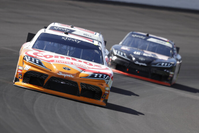 NASCAR Xfinity Series driver Kyle Busch drives into turn one during the NASCAR Xfinity auto race at the Indianapolis Motor Speedway, Saturday, Sept. 7, 2019 in Indianapolis. (AP Photo/Darron Cummings)
