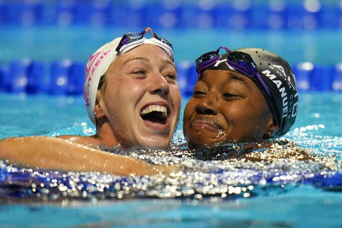 Simone Manuel and Abbey Weitzeil react after the women's 50 freestyle during wave 2 of the U.S. Olympic Swim Trials on Sunday, June 20, 2021, in Omaha, Neb. (AP Photo/Jeff Roberson)