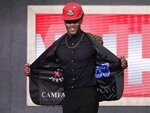 Duke's Cam Reddish shows off his jacket after the Atlanta Hawks selected him as the 10th overall pick in the NBA basketball draft Thursday, June 20, 2019, in New York. (AP Photo/Julio Cortez)