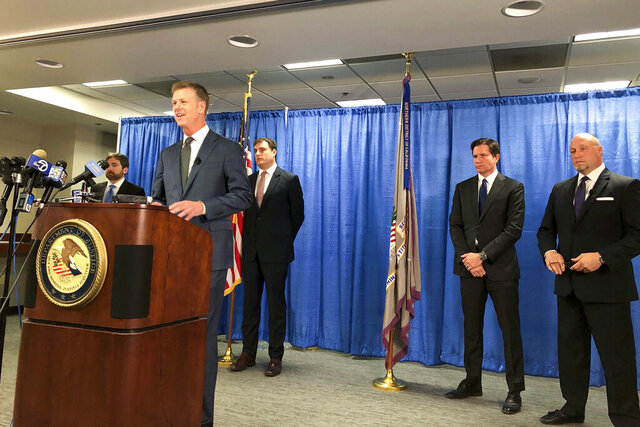 FILE - In this Sept. 30, 2019, file photo, U.S. attorney David Anderson announces criminal spy charges against San Francisco Bay Area tour operator Xuehua Edward Peng, in San Francisco. Xuehua Edward Peng was sentenced to four years in prison for serving as an unregistered agent for China's ministry of state security in a scheme to use