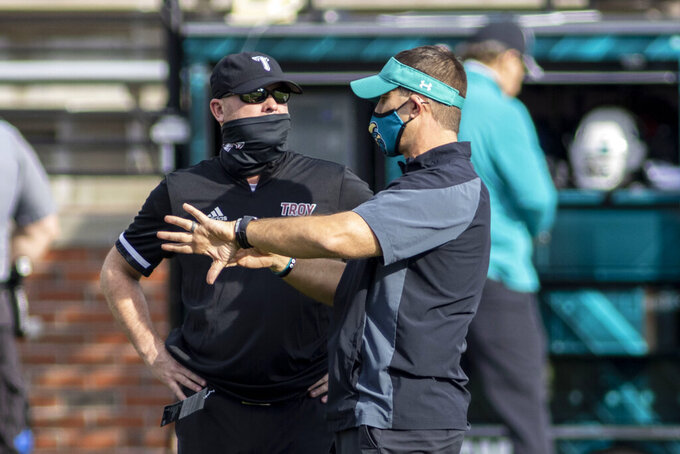 Troy head coach Chip Lindsey talks with Coastal Carolina head coach Jamey Chadwell before an NCAA college football game, Saturday, Dec. 12, 2020, in Troy, Ala. (AP Photo/Vasha Hunt)