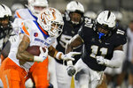 Boise State running back Cyrus Habibi-Likio, left, looks to run past Central Florida linebacker Jeremiah Jean-Baptiste (11) during the first half of an NCAA college football game Thursday, Sept. 2, 2021, in Orlando, Fla. (AP Photo/John Raoux)