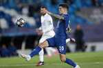 Chelsea's Christian Pulisic reaches for the ball during the Champions League semifinal first leg soccer match between Real Madrid and Chelsea at the Alfredo di Stefano stadium in Madrid, Spain, Tuesday, April 27, 2021. (AP Photo/Bernat Armangue)