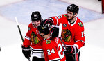 Chicago Blackhawks center Dominik Kahun (24) celebrates with left wing Brandon Saad (20) and center Artem Anisimov (15) after scoring against the Dallas Stars during the second period of an NHL hockey game Friday, April 5, 2019, in Chicago. (AP Photo/Matt Marton)