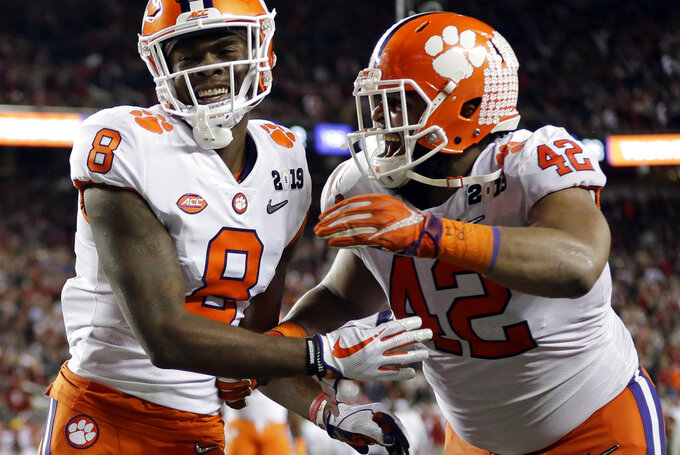 Clemson's Justyn Ross celebrates his touchdown catch with Christian Wilkins (42) during the second half of the NCAA college football playoff championship game against Alabama, Monday, Jan. 7, 2019, in Santa Clara, Calif. (AP Photo/David J. Phillip)