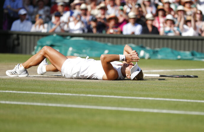 Angelique Kerber of Germany celebrates defeating Serena Williams of the US in the women's singles final match at the Wimbledon Tennis Championships, in London, Saturday July 14, 2018. (Nic Bothma, Pool via AP)