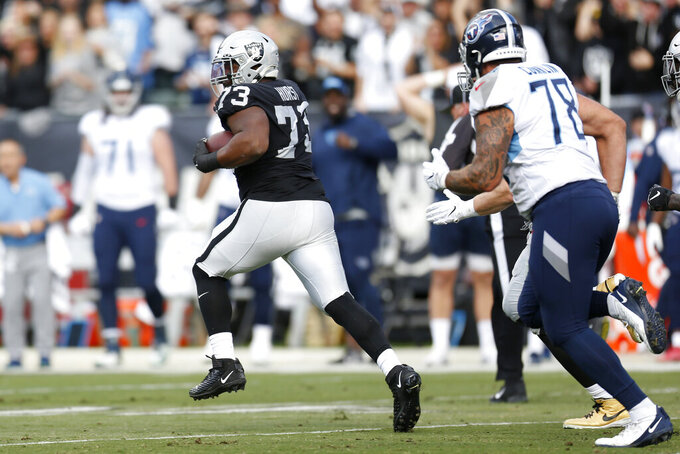 Oakland Raiders defensive tackle Maurice Hurst (73) runs after intercepting a pass against the Tennessee Titans during the first half of an NFL football game in Oakland, Calif., Sunday, Dec. 8, 2019. (AP Photo/D. Ross Cameron)
