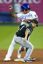 Kansas City Royals' Adalberto Mondesi, top, is tagged out by Chicago White Sox second baseman Nick Madrigal (1) during the seventh inning of a baseball game at Kauffman Stadium in Kansas City, Mo., Saturday, Sept. 5, 2020. Mondesi was caught stealing on the play. (AP Photo/Orlin Wagner)