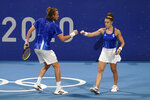 Stefanos Tsitsipas, left, and Maria Sakkari, of Greece, bump fists during a mixed doubles quarterfinal tennis match against Ashleigh Barty and John Peers, of Australia, at the 2020 Summer Olympics, Thursday, July 29, 2021, in Tokyo, Japan. (AP Photo/Patrick Semansky)