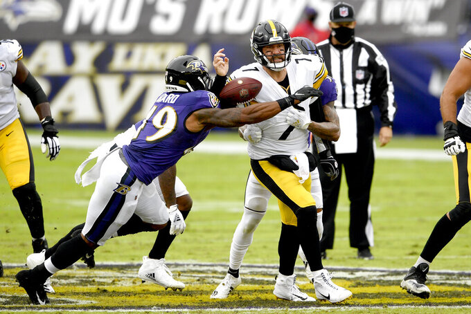 Pittsburgh Steelers quarterback Ben Roethlisberger (7) loses the ball while getting pressure from Baltimore Ravens linebacker Chris Board (49), cornerback Anthony Averett (23) and defensive end Yannick Ngakoue (91) during the first half of an NFL football game, Sunday, Nov. 1, 2020, in Baltimore. Roethlisberger recovered his fumble on the play. (AP Photo/Nick Wass)