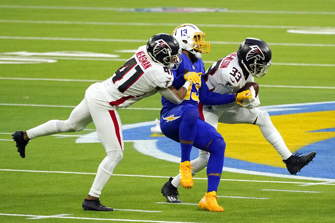 Atlanta Falcons cornerback Blidi Wreh-Wilson (33) intercepts a pass intended for Los Angeles Chargers wide receiver Keenan Allen, center, during the second half of an NFL football game Sunday, Dec. 13, 2020, in Inglewood, Calif. (AP Photo/Ashley Landis)