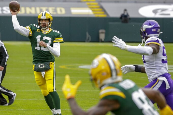 Green Bay Packers' Aaron Rodgers throws a pass during the first half of an NFL football game against the Minnesota Vikings Sunday, Nov. 1, 2020, in Green Bay, Wis. (AP Photo/Mike Roemer)