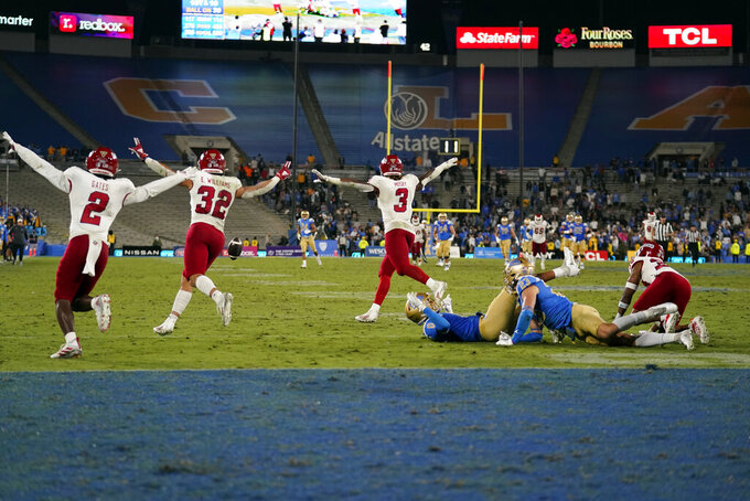 Fresno State players celebrate after an incomplete Hail Mary pass to end the NCAA college football game against UCLA Sunday, Sept. 19, 2021, in Pasadena, Calif. (AP Photo/Marcio Jose Sanchez)
