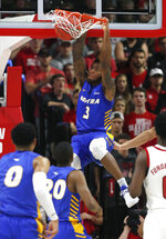 Hofstra's Justin Wright-Foreman (3) slams in two against North Carolina State during the first half of an NCAA college basketball game in Raleigh, N.C., Tuesday, March 19, 2019. (Ethan Hyman/The News & Observer via AP)
