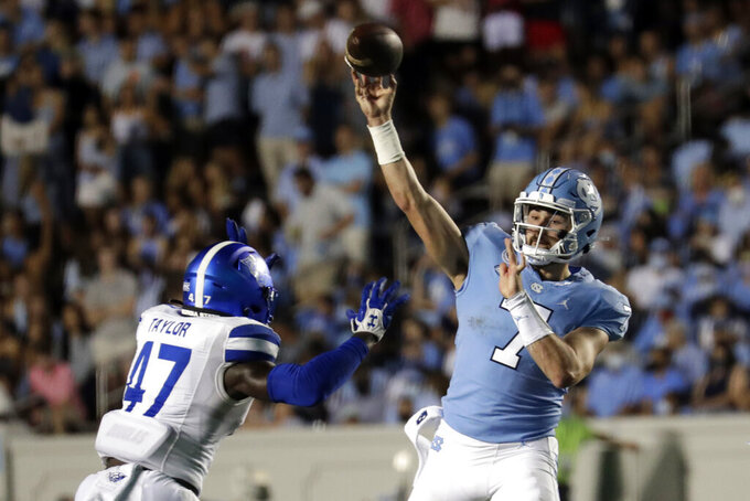 North Carolina quarterback Sam Howell (7) passes over Georgia State linebacker Jhi'Shawn Taylor (47) during the first half of an NCAA college football game in Chapel Hill, N.C., Saturday, Sept. 11, 2021. (AP Photo/Chris Seward)