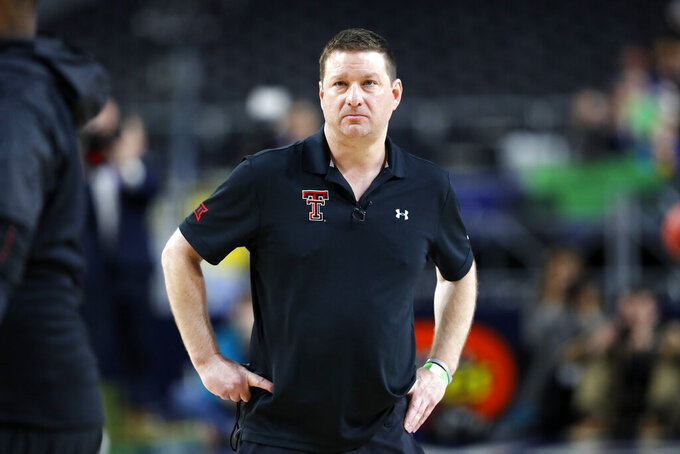 Texas Tech head coach Chris Beard watches his team during a practice session for the semifinals of the Final Four NCAA college basketball tournament, Friday, April 5, 2019, in Minneapolis. (AP Photo/Charlie Neibergall)