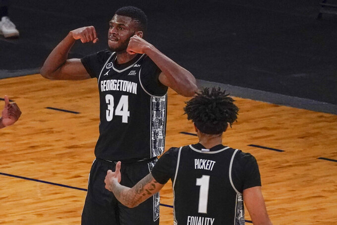 Georgetown center Qudus Wahab (34) and forward Jamorko Pickett (1) celebrate after Wahab scored during the second half of an NCAA college basketball game against Villanova in the quarterfinals of the Big East conference tournament, Thursday, March 11, 2021, in New York. Georgetown won 72-71. (AP Photo/Mary Altaffer)