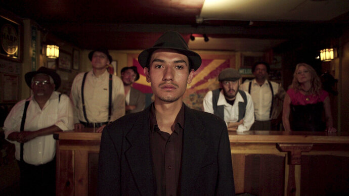 This undated photo provided by 4th Row Films shows Fernando Serrano, 23, who plays a striking miner in