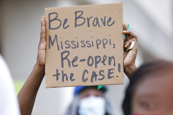 A protester holds a sign during a protest Friday, June 5, 2020, at the in Jackson, Miss., over Mississippi Attorney General Lynn Fitch's recent decision to drop a manslaughter charge against former Columbus Police Officer Canyon Boykin. Boykin, who is white, had been charged in the October 2015 shooting death of an African American man, Ricky Ball. (AP Photo/Rogelio V. Solis)