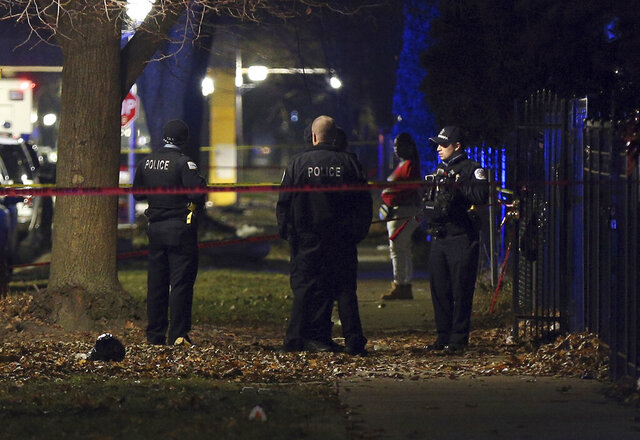 Chicago police guard a crime scene in the 5700 block of S. May Street in Chicago after several people were shot there on Sunday, Dec. 22, 2019. (Terrence Antonio James/Chicago Tribune via AP)