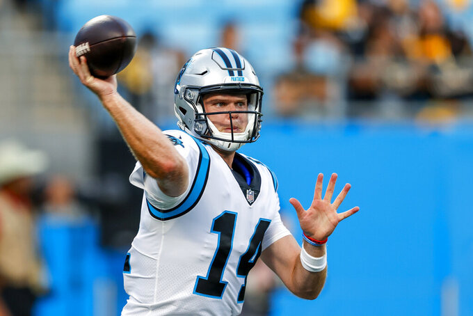 FILE - In this Friday, Aug. 27, 2021, file photo, Carolina Panthers quarterback Sam Darnold warm ups before a preseason NFL football game against the Pittsburgh Steelers in Charlotte, N.C. Darnold gears up to face his former team, the New York Jets, in the season opener on Sunday. (AP Photo/Nell Redmond, File)