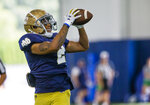 Xavier Watts makes a catch during Notre Dame NCAA college football practice in South Bend, Ind., Thursday, Aug. 12, 2021. (Michael Caterina/South Bend Tribune via AP)