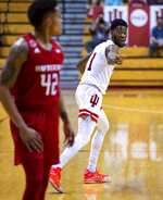 Indiana guard Al Durham (1) reacts towards Rutgers guard Jacob Young (42) after Young failed to block Durham's 3-point shot during the second half of an NCAA college basketball game, Sunday, Jan. 24, 2021, in Bloomington, Ind.  (AP Photo/Doug McSchooler)