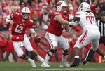 Wisconsin's Alex Hornibrook scrambles during the first half of an NCAA college football game against Rutgers Saturday, Nov. 3, 2018, in Madison, Wis. (AP Photo/Morry Gash)