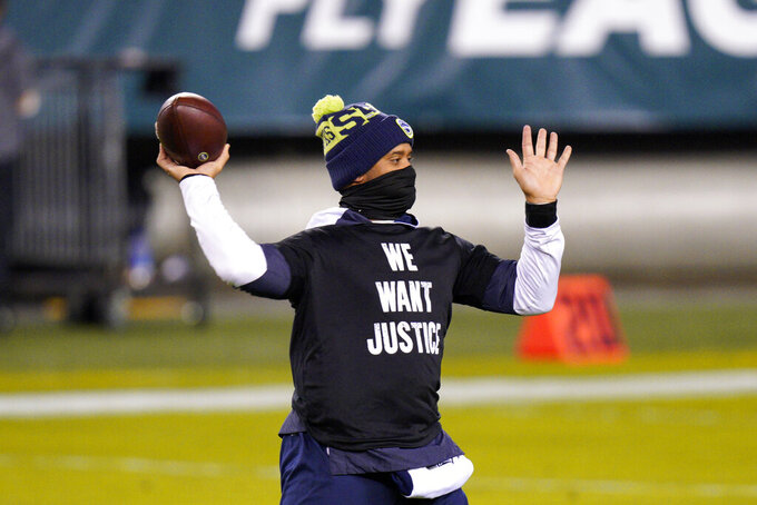 Seattle Seahawks' Russell Wilson warms up before an NFL football game against the Philadelphia Eagles, Monday, Nov. 30, 2020, in Philadelphia. (AP Photo/Chris Szagola)