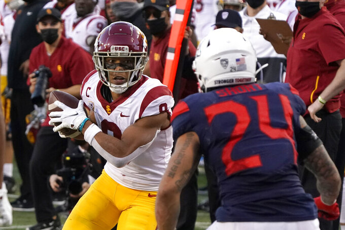 Southern California wide receiver Amon-Ra St. Brown (8) looks to get past Arizona defensive back Rhedi Short during the second half during an NCAA college football game Saturday, Nov. 14, 2020, in Tucson, Ariz. Southern California won 34-30. (AP Photo/Rick Scuteri)
