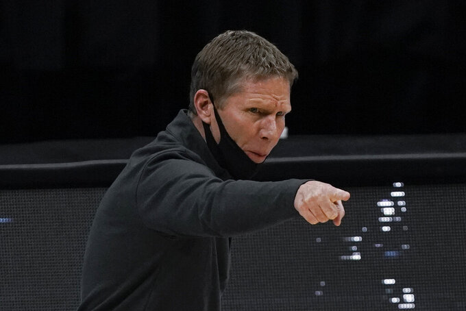 Gonzaga head coach Mark Few directs his team during the first half of a men's Final Four NCAA college basketball tournament semifinal game against UCLA, Saturday, April 3, 2021, at Lucas Oil Stadium in Indianapolis. (AP Photo/Michael Conroy)
