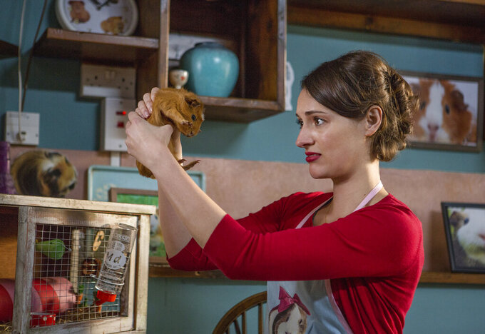 """This image released by Amazon shows Phoebe Waller-Bridge in a scene from, """"Fleabag."""" Amazon is streaming """"Fleabag,"""" the one-woman stage show that launched the lauded television series, with all proceeds going to communities affected by COVID-19. The live 80-minute event is different from the TV series, but fans can see the germ of ideas that would enliven the Emmy-winning show. (Luke Varley/Amazon via AP)"""