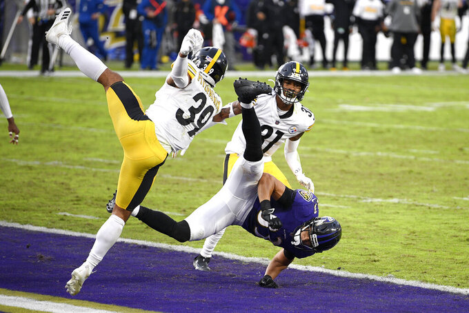 Pittsburgh Steelers free safety Minkah Fitzpatrick (39) collides with Baltimore Ravens wide receiver Willie Snead, bottom, while braking up a pass in the end zone with no time left in the second half of an NFL football game, Sunday, Nov. 1, 2020, in Baltimore. The Steelers won 28-24. Steelers cornerback Justin Layne (31) looks on during the play. (AP Photo/Nick Wass)
