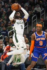 Milwaukee Bucks' Wesley Matthews shoots over New York Knicks' RJ Barrett during the second half of an NBA basketball game Tuesday, Jan. 14, 2020, in Milwaukee. (AP Photo/Morry Gash)
