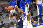DePaul's Pauly Paulicap, right, blocks a pass by Connecticut's Adama Sanogo, left, during the first half of an NCAA college basketball game Monday, Jan. 11, 2021, in Chicago. (AP Photo/Charles Rex Arbogast)