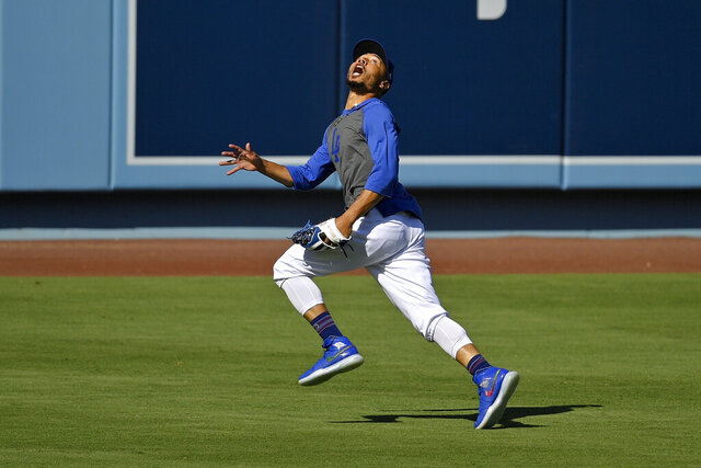 Los Angeles Dodgers right fielder Mookie Betts fields a fly ball during the restart of baseball spring training Sunday, July 5, 2020, in Los Angeles. (AP Photo/Mark J. Terrill)